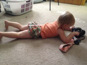 Checking out pictures of herself. :)