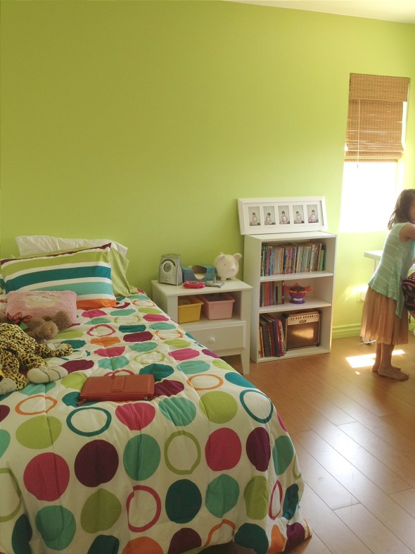 Aly picked out the bedspread and accent wall color herself.