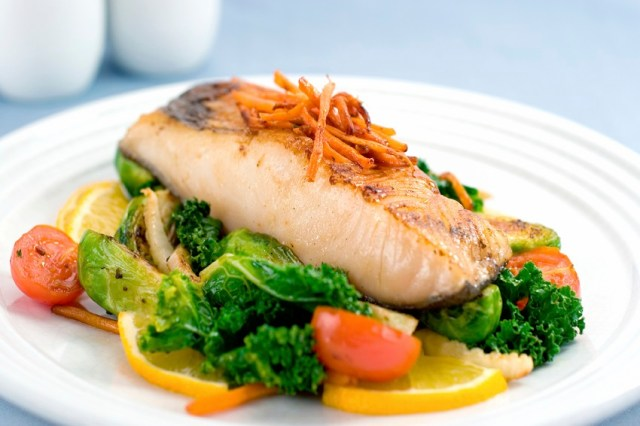 A delicious filet of rich Black Cod served atop braised brussel sprouts, kale, fennel and tomato. Shallow dof.
