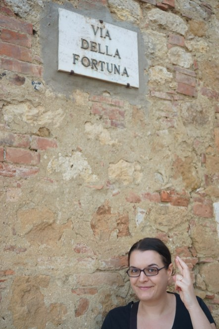 Me under the Fortune sign doing a propitiatory gesture