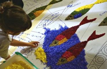 Little girl placing petals