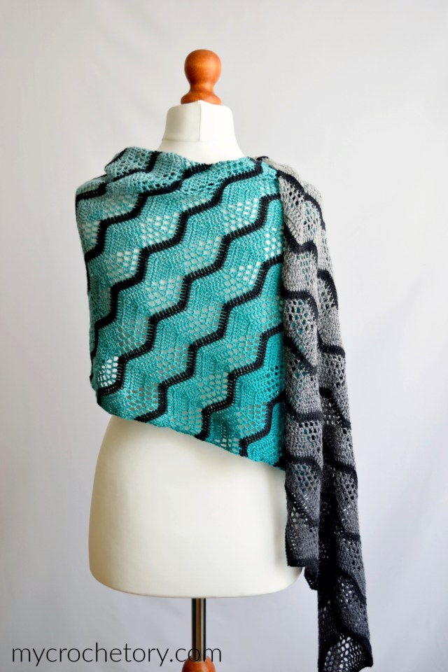 This Havra Crochet Wrap pattern combines a simple stitch, bias crocheting and ombre yarn to create a wearable crochet shawl that may be worn in a variety of ways! Free crochet pattern on my blog mycrochetory.com
