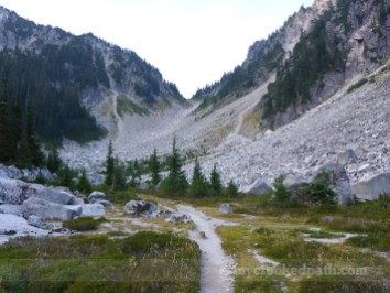 The old Cascade Crest trail heads over that saddle. The PCT does not.