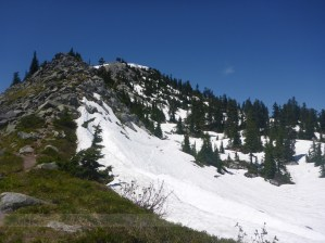 The summer trail heads right through the snowfield. I took the more direct route up the ridge.