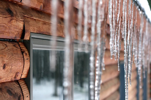 icicles on a log cabin