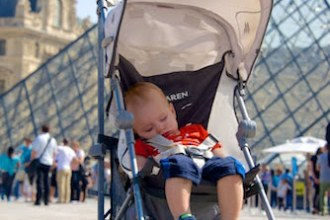 child asleep in stroller