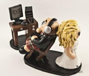 Bride Dragging Gaming Groom in Kilt Cake Topper
