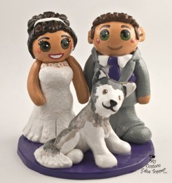 Bride and groom with husky dog cake topper