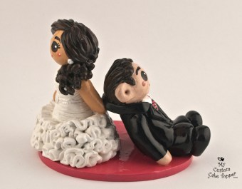 Classic bride dragging her groom wedding cake topper