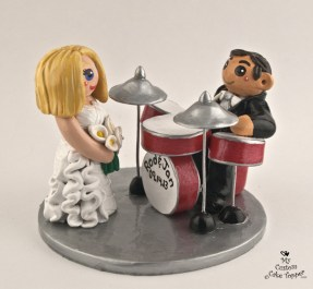 Groom playing drums wedding cake topper