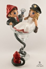 Police bride and fireman groom relaxing in a margarita glass