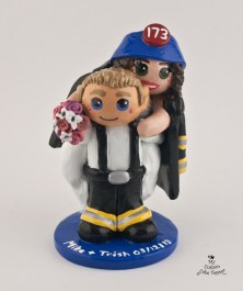 Bride on her fireman grooms back cake topper
