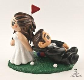 Bride dragging her golfing groom cake topper