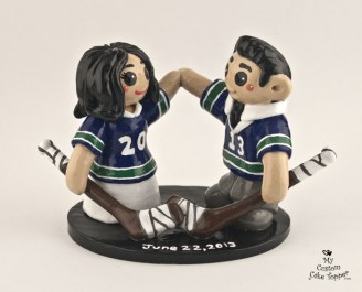 Bride and Groom Playing Hockey Wedding Cake Topper