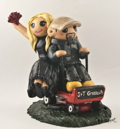 Bride And Groom Riding A Lawn Mower Cake Topper