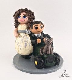 Bride And Groom Riding Tractor With Cat Cake Topper