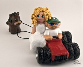 Bride And Groom Riding Tractor With A Horse Cake Topper