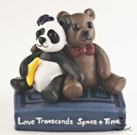 Teddy And Panda On Book Cake Topper