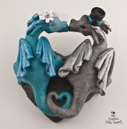 Dragons forming a heart silver and teal cake topper