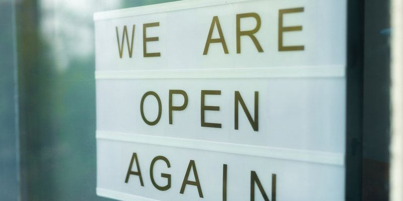 small businesses open again sign