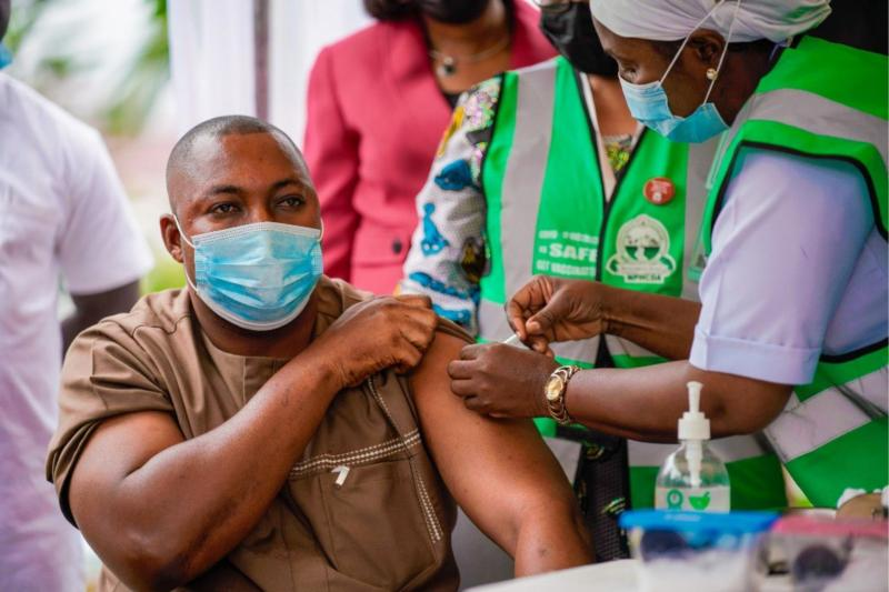 Alhaji Hassan a police officer receiving COVID 19 vaccine during the flag off of the second phase covid 19 vaccination at FMC Jabi Abuja