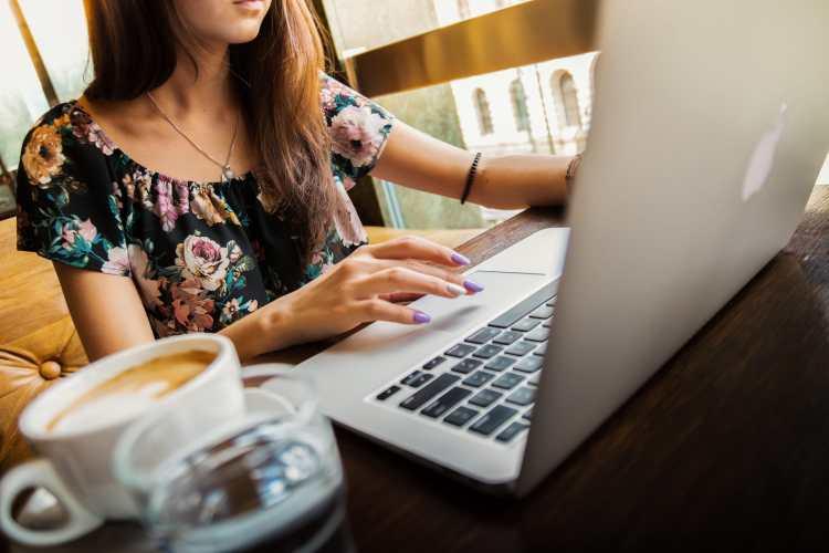 woman laptop coffee salary