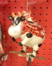 Skiing cow ornament