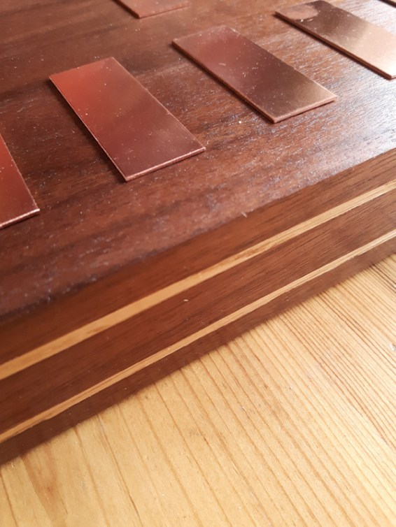 Close-up detailing of the wooden sandwich effect made from walnut and oak