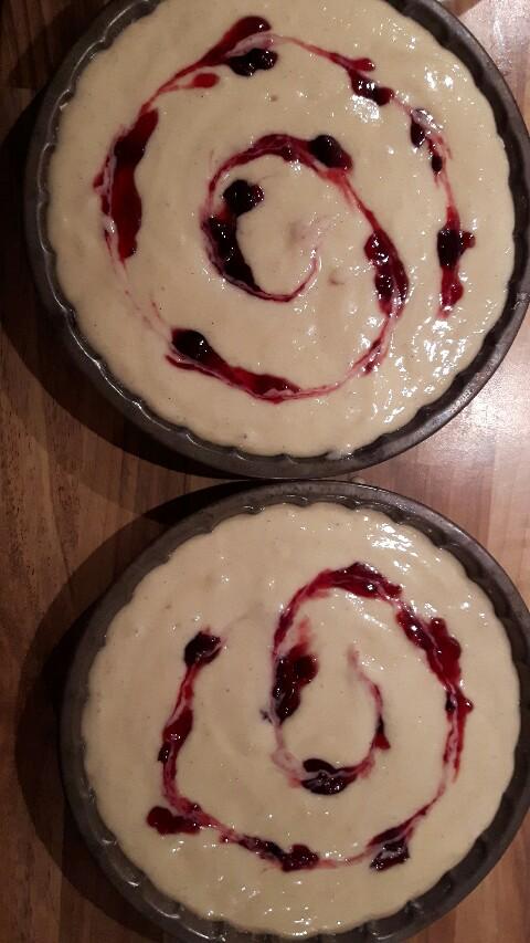 Jam swirl on top of cake mixture