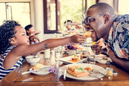 Family sharing food at a celebration