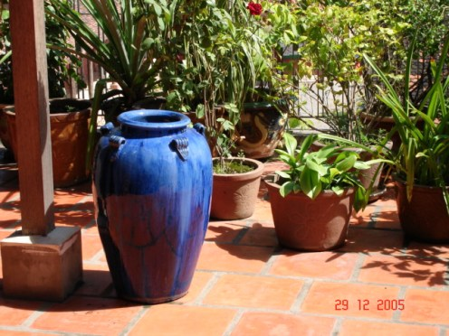 To break the monotony of the read tiles and red planters ... the blue vase is a welcome burst of color