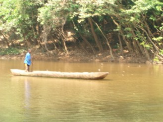 One of my colleague riding the dug out canoe