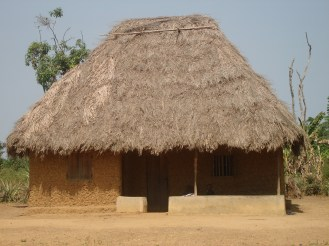 typical house in the bush -- its dark, smokey but cool during summer and warm during rainy season all made from mud