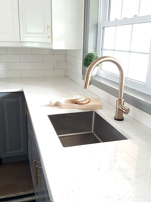 should kitchen faucet match cabinets
