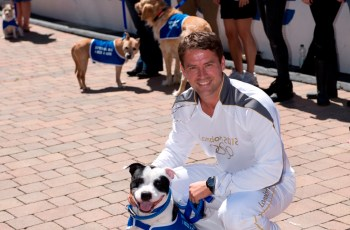 Michael Owen and Rory Footballer Michael Owen Takes The London 2012 Olympic Torch To The Dogs