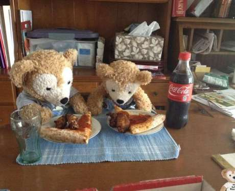 Duffy the Disney Bear and Little Joe eating their Papa Johns Pepperoni Pizza and Wings