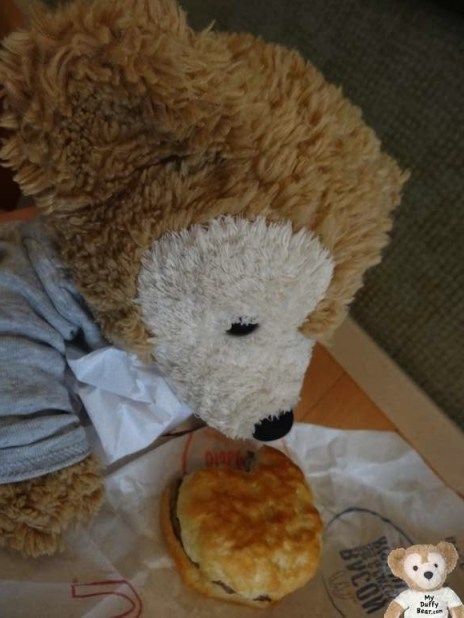 Duffy the Disney Bear takes a bite out of his McDonalds Sausage Biscuit