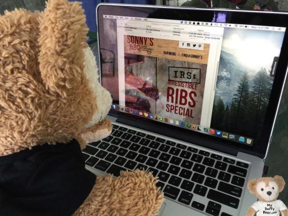 Duffy the Disney Bear jumps almost jumps through his computer to taste the Sonny's BBQ Ribs