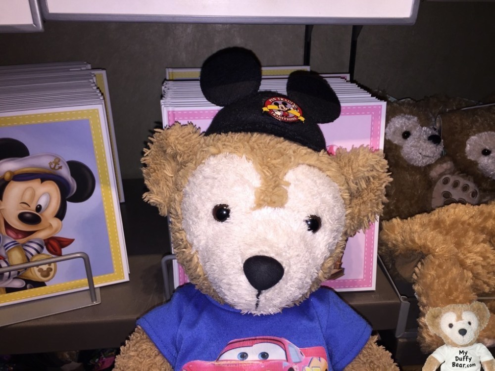 Duffy the Disney Bear stands in front of his surprise