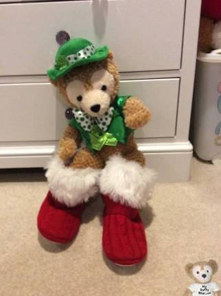 Duffy the Disney Bear put on his Owner's red Santa Slippers!