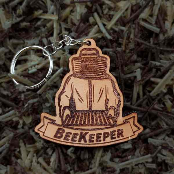 Beekeper shaped Keychain in light leather