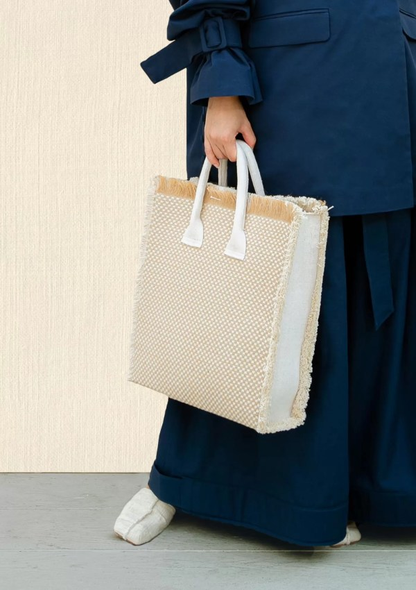 woman carrying large shopper bag made from sustainable cotton and hemp