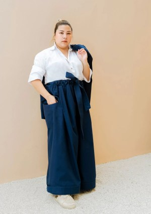 woman wearing oversized dark blue trousers made from organic and recycled cotton