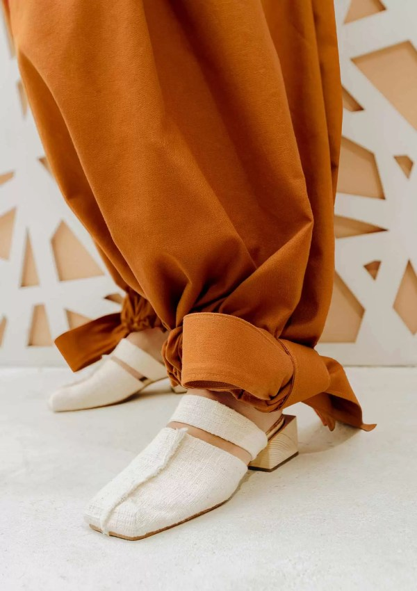Orange trousers made from organic and recycled cotton