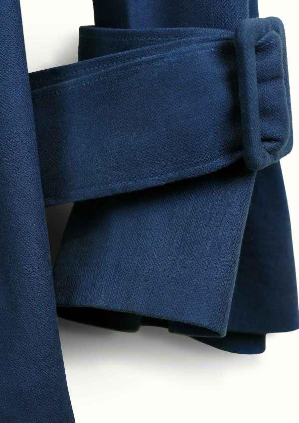 Detail of dark blue blazer made from organic cotton