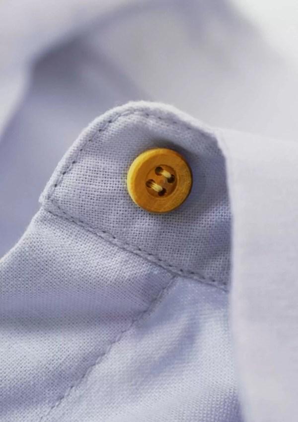 Button on light blue cotton shirt