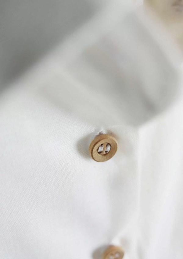 Button on white cotton shirt