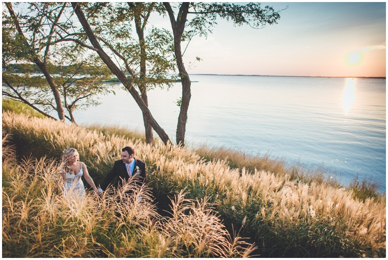 bride and groom with the sunset at chesapeake bay beach club