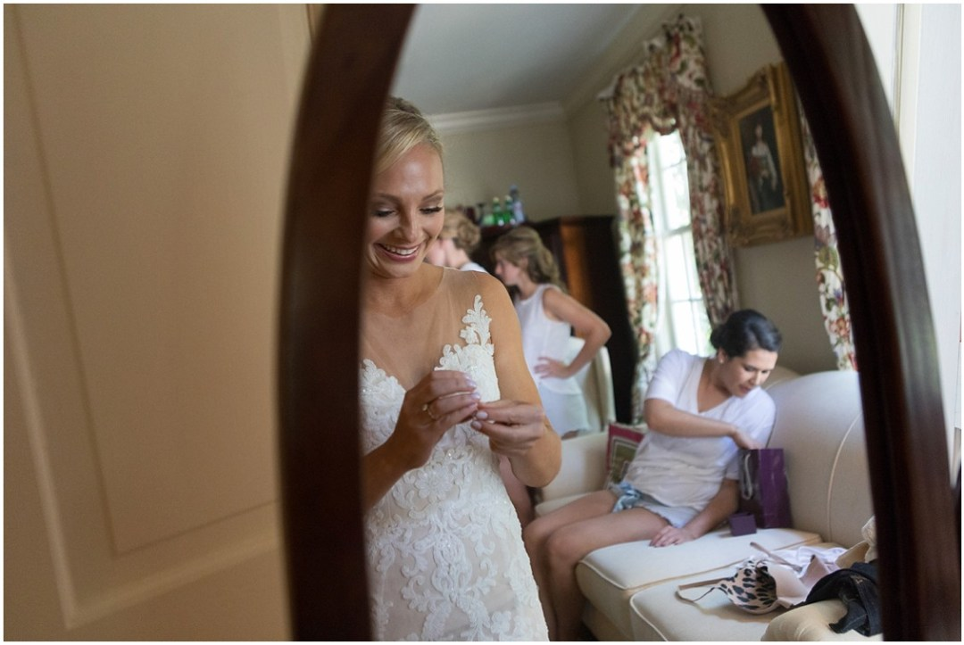 Bride getting ready with her bridesmaids. | My Eastern Shore Wedding |
