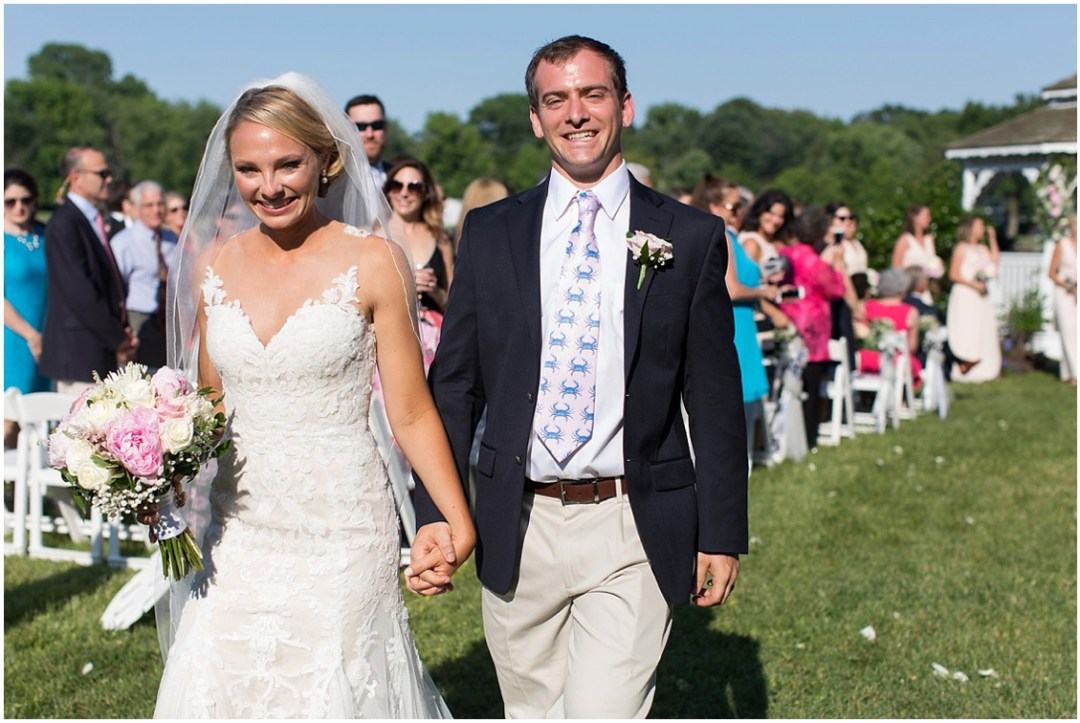 Bride and groom walking down the aisle together after being married. | My Eastern Shore Wedding |